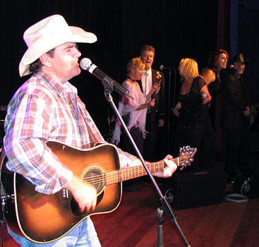 WAYNE LAW onstage with the Canterbury Country Corral behind...