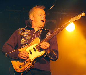 Tommy Emmanuel with electric guitar